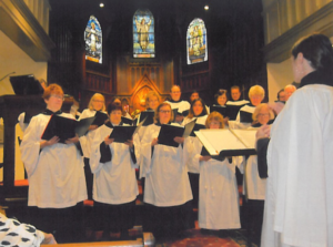 Choir singing in front of church
