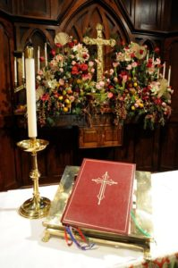 Bible and candle at altar